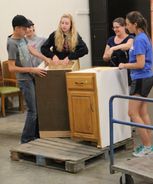 Living Lord Youth Group volunteering at the ReStore