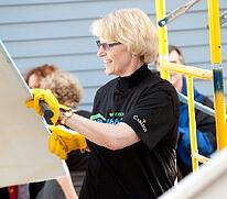 Carlson CEO Trudy Rautio volunteering with Twin Cities Habitat for Humanity