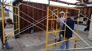 Troy, Bill and Phil set up scaffolding