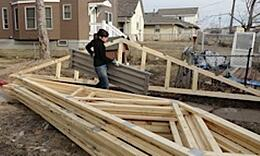 Amanda among the trusses carrying flooring for the scaffolds