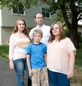 Bobbie Cox and her family, the 1000th homebuyer family served by Twin Cities Habitat