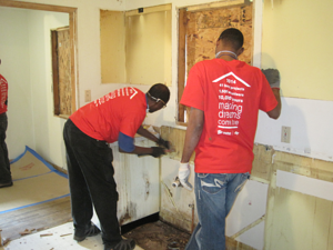 volunteers performing demolition for the home rehab project