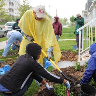 Master Gardener helping homeowner install plants