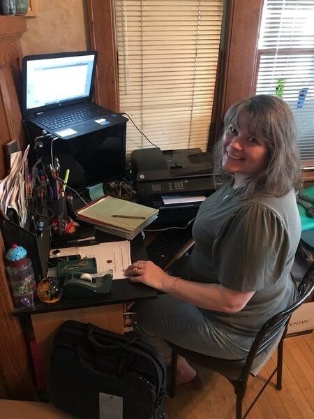 Juanita in her home office.