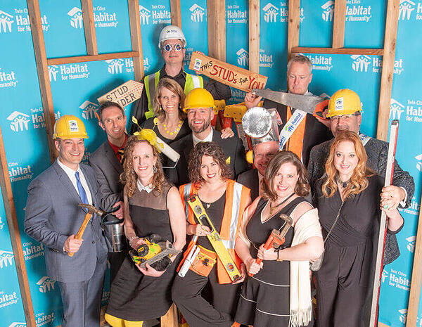 A group from the 2019 Hard Hat & Black Tie Gala, wearing various construction-related outfits.