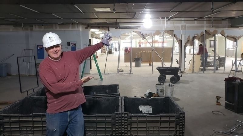 Pete O'Keefe showing off the demolition of one of the walls in the New Brighton ReStore during the remodel.