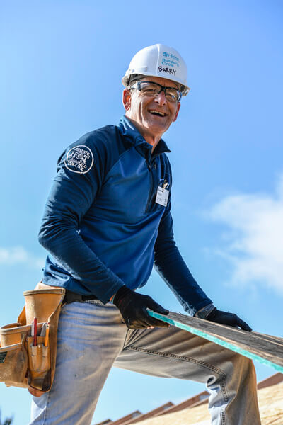 Barry Mason working on a roof.