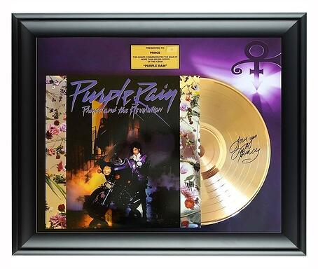"A black framed piece holding the album Purple Rain: Prince and the Revolution. The album has a background of scattered flowers, with a dark centered photo of Prince on a motorcycle in an alleyway, with a woman at the top of a staircase. The disc is halfway out of the sleeve and signed by Prince. The background in the frame is purple with the Prince logo in the top right corner. Centered at the top of the frame is a gold box saying ""Presented to Prince: This award commemorates the sale of more than 500,000 copies of the album 'Purple Rain'""."