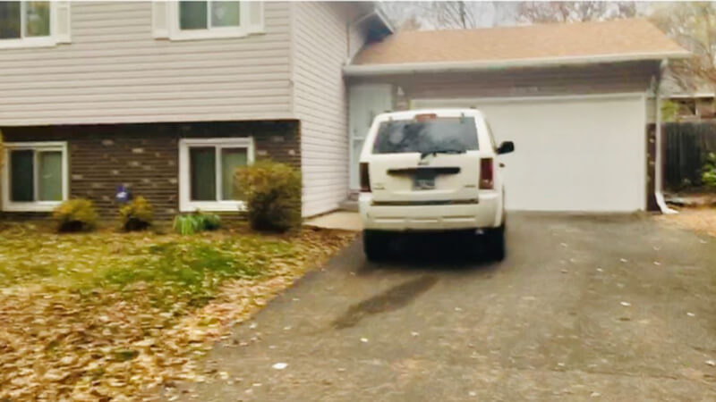 The outside of Hafza's home, with a white SUV in the driveway