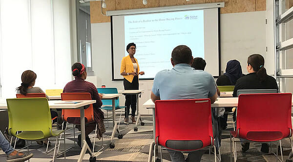Habitat clients participate in a homeownership education class.