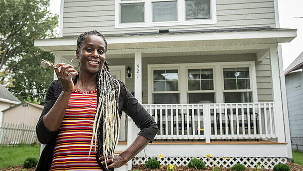 LeAndra holding the keys to the home she bought with Twin Cities Habitat in 2019.