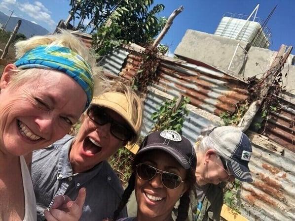 Four volunteers posing in the Dominican Republic.