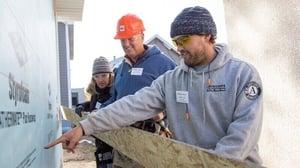 An AmeriCorps member instructing volunteers.