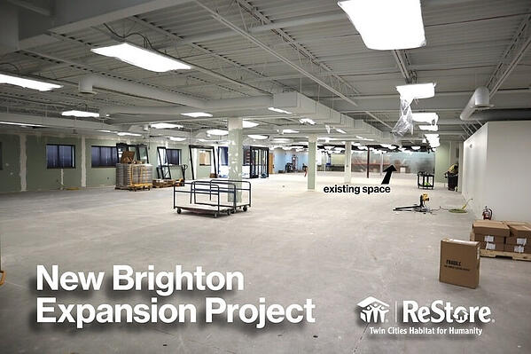 """The interior of the New Brighton location under construction. White text says """"New Brighton Expansion Project"""" with the ReStore logo at the bottom right."""