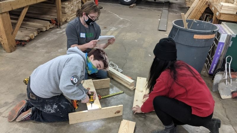Avery, Griffin, and Sarah building boxes at the Warehouse.
