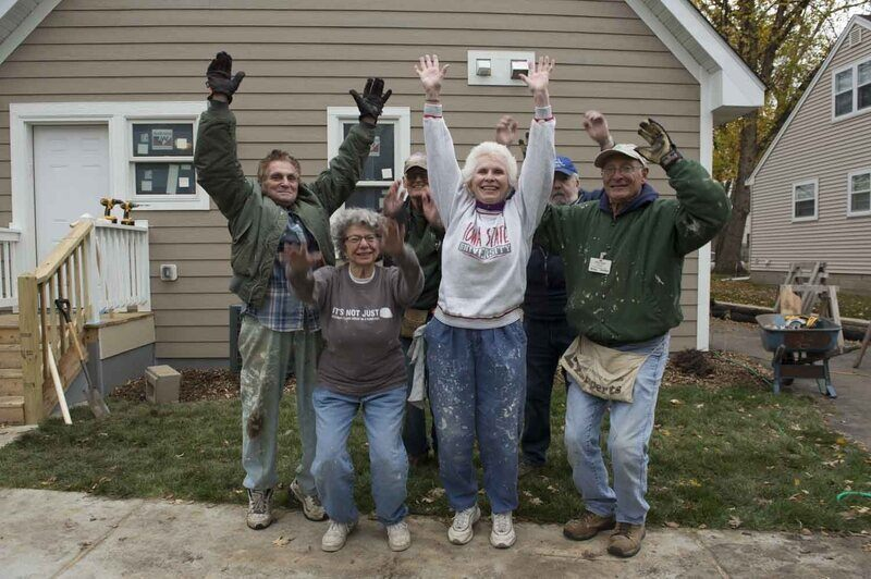 The JCRC Reg Crew with their hands in the air.