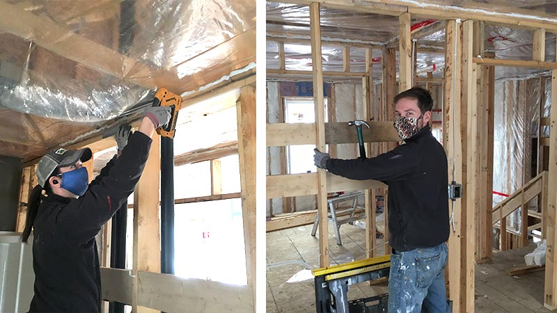 Team members framing one of the homes.