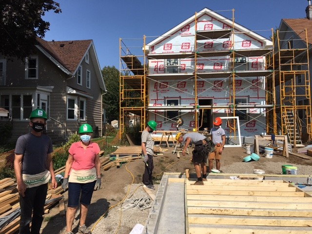 Karen next to her son Chris (left) as more progress is made on the home.