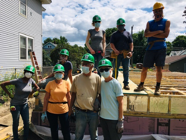 The Olsons with a group of volunteers on a build site.