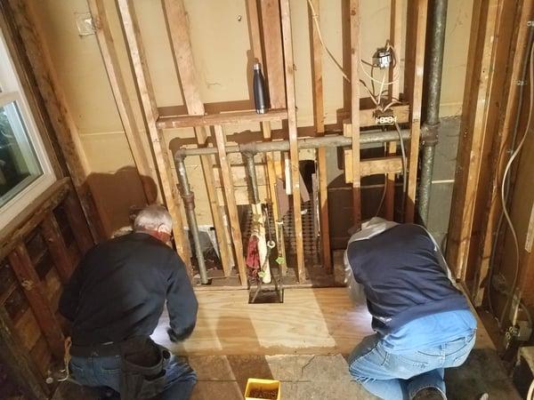 Staff working on plumbing in Karin's house.