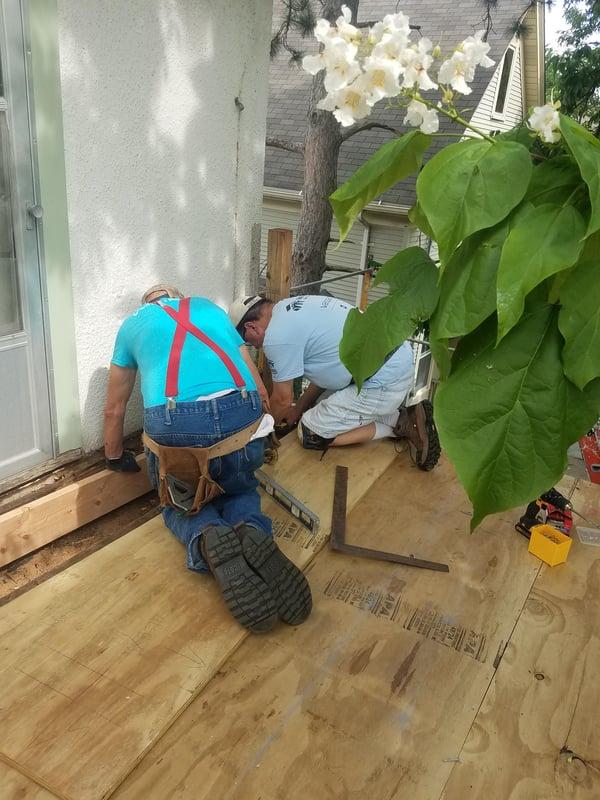 Volunteers working on Karin's back porch.