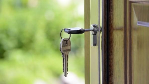 Keys in a front door lock.