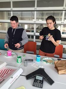Two students decorating cookies.