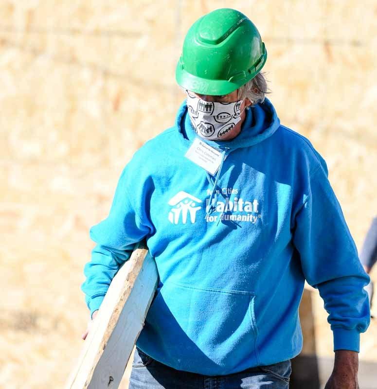 Chris Coleman wearing a mask on a Habitat construction site