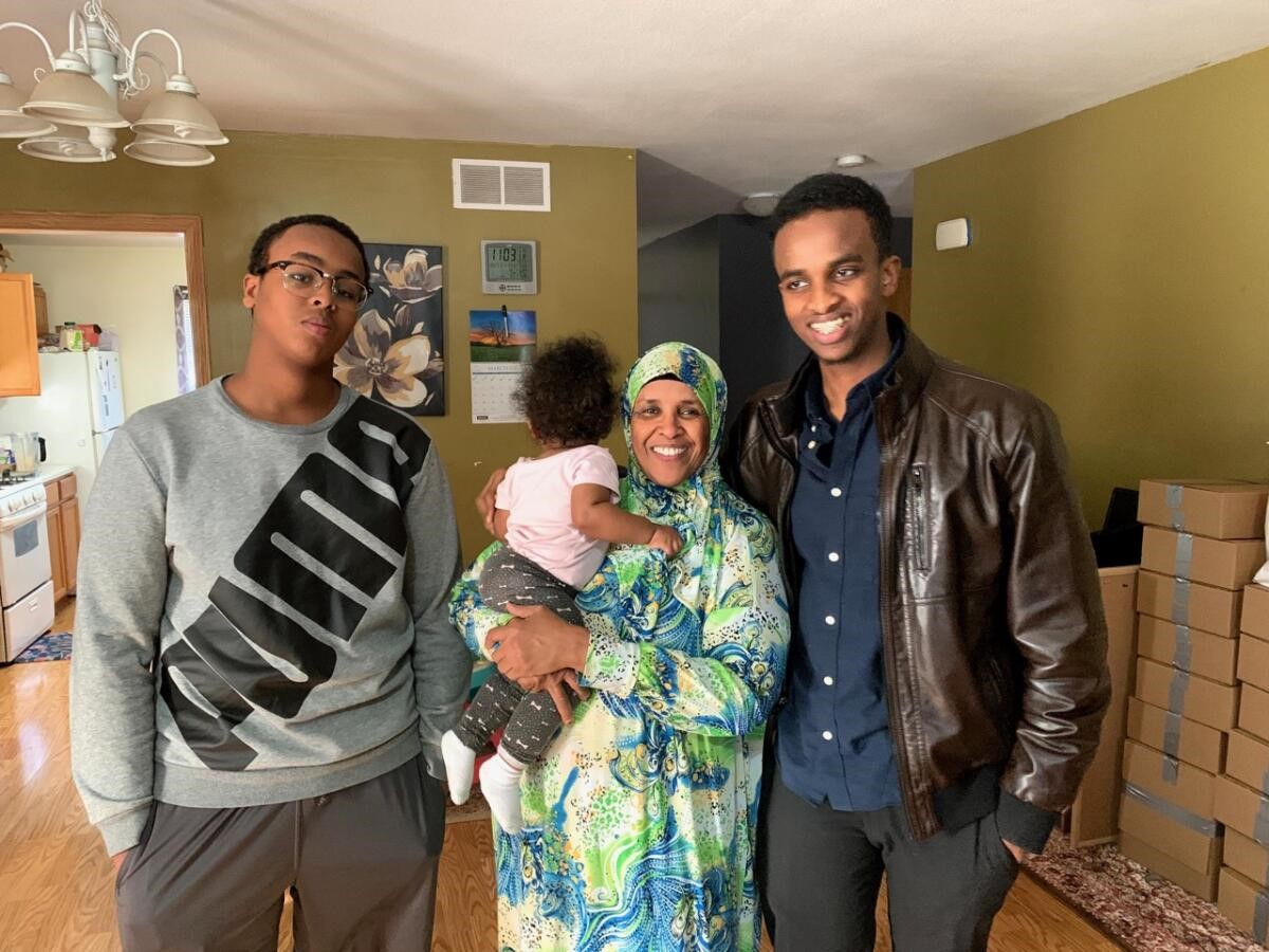 Hamida and her family in her home