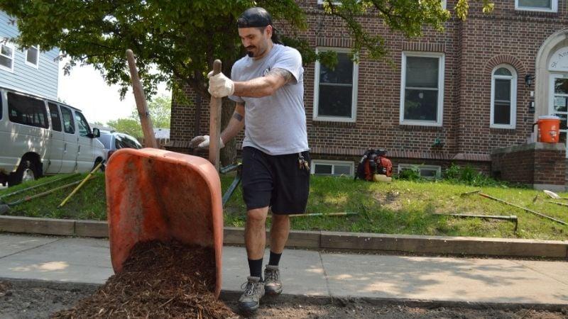 David moving mulch during Jordan Week of Kindness.