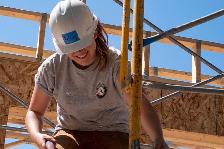 AmeriCorps member on scaffolding