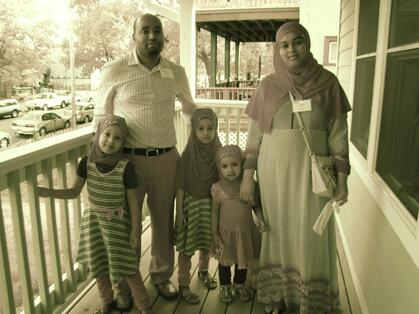 new homeowners Mohamed and Caltu and their family