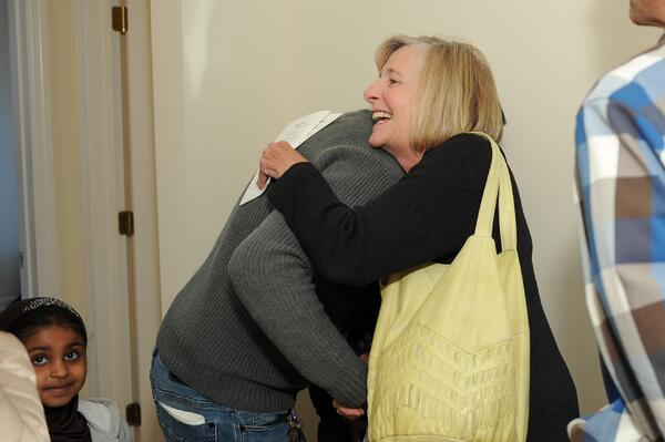 Sue congratulating homeowner