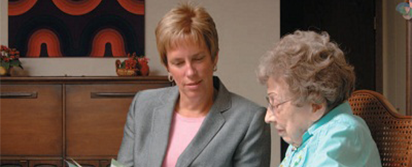 photo of woman with advisor; links to What Is Planned Giving page
