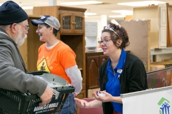 CJ_and_Anne_tabling_at_ReStore_sale