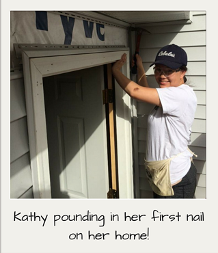 Kathy pounding in her first nail on her home!