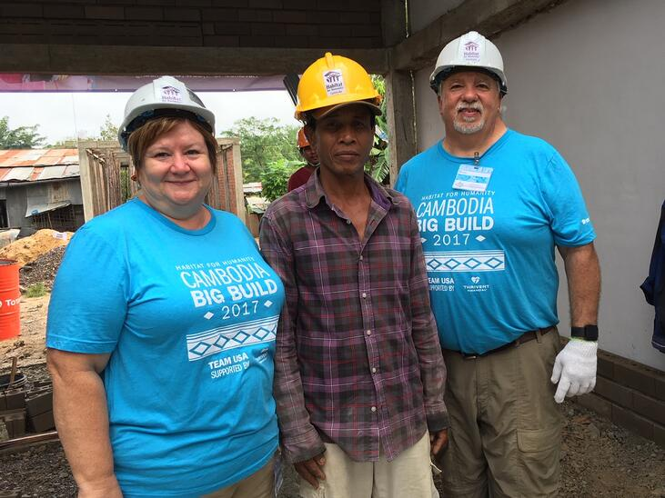 cambodia volunteers with homeowner.jpeg