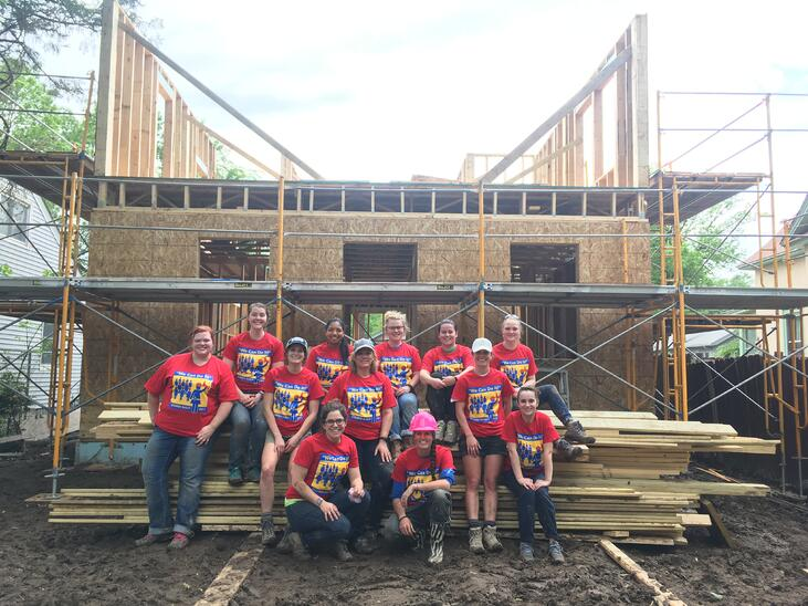 America and team on a women build site