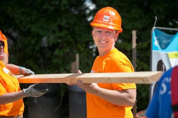 A happy volunteer from Andersen's Women Build Team