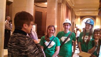 Housing advocates with Representative Alice Hausman.