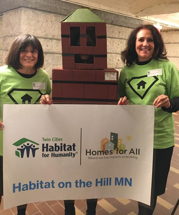 "Sharon and her friend with ""Bill Ding,"" our housing advocacy mascot."