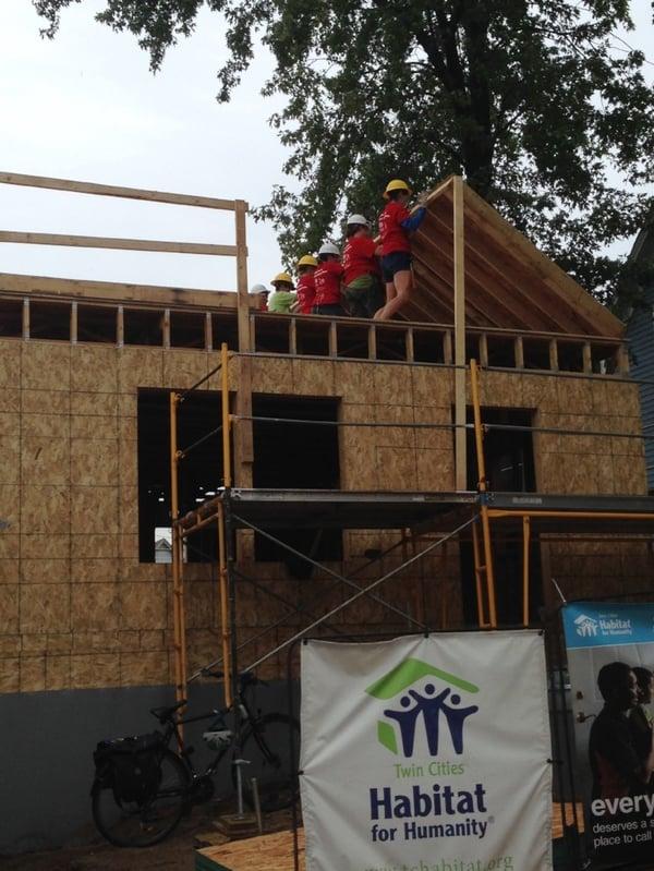 Women Build team raising a wall on the second floor