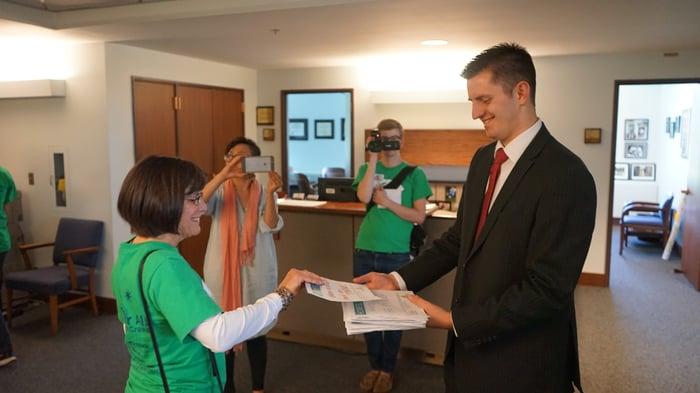 Sharing delivering her letter to a legislative aid.