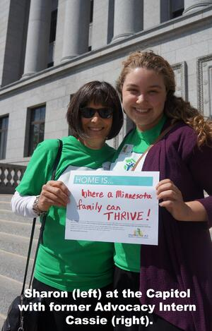 "Sharon at the Capitol with former Advocacy Intern Cassie. Her sign says ""Home is where a Minnesota family can thrive!"""