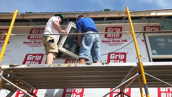 Installing a window during the neighbors' build day