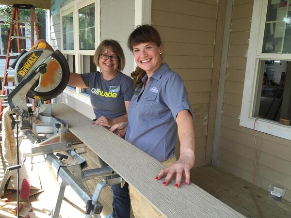 Robyn working on siding on a Habitat build site.