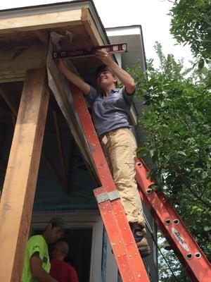Robyn on a ladder.