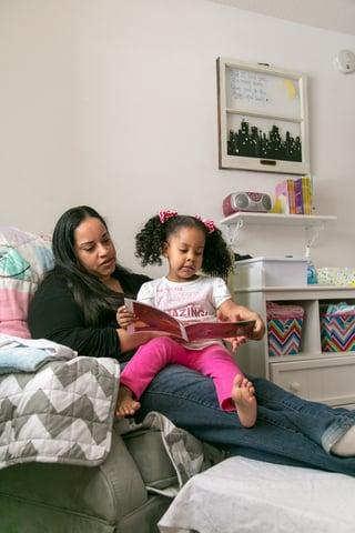 Kera and daughter reading