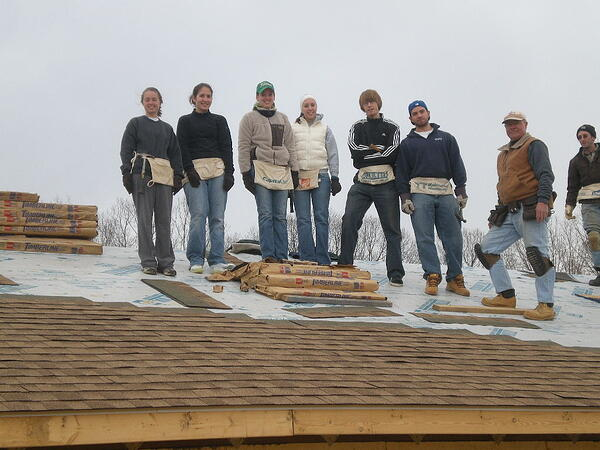 Bob roofing with college students