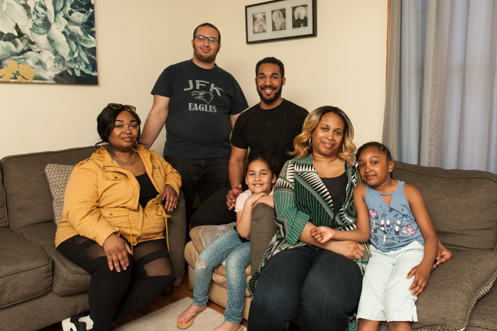 DeAngela and her family in their living room